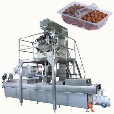 термоформовочная вакуумная упаковочная машина с весовым дозатором для упаковки мелкокусочных продуктов в Москве